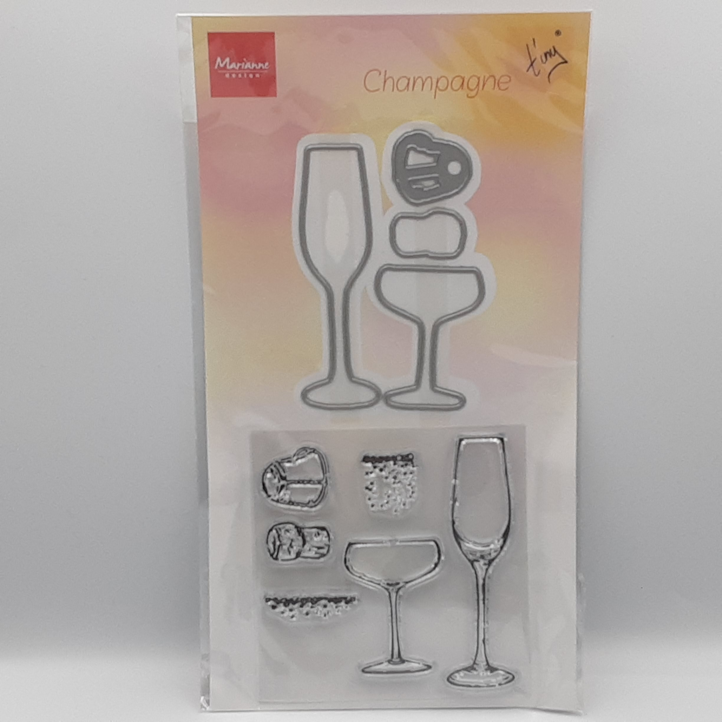 Tiny's champagne stamps and dies